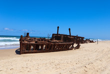 Old Wrecked Ship On The Sand By The Water