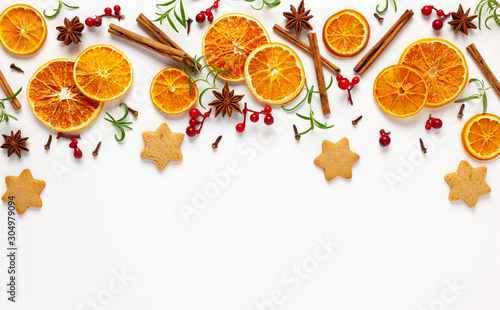 Obraz  Christmas composition with cookies, dried oranges, cinnamon sticks and herbs on white background. Natural food ingredient for cooking or Christmas decor for home. Flat lay. - fototapety do salonu