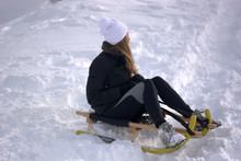 The Girl Has Fun On The Sled