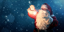 Happy Santa Claus Holding Glow...