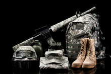 Military Supplies On Black Background.