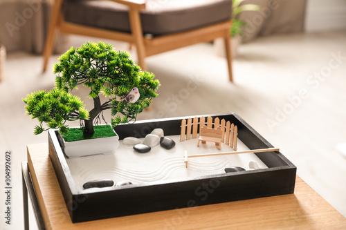 Beautiful miniature zen garden on wooden table indoors - 304992692