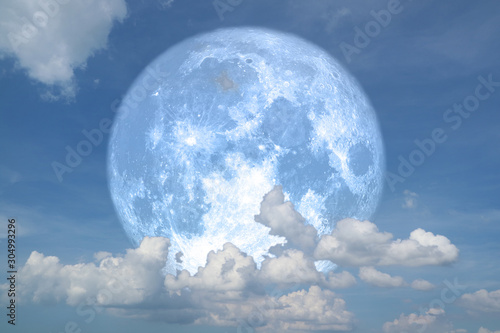 blue strawberry moon back on silhouette heap cloud on night sky Canvas Print