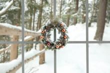 Beautiful Christmas Wreath Hanging On Window
