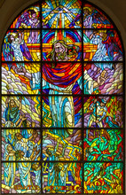 """Zegiestow, Poland. 2019/8/10. Stained-glass Window Depicting Jesus Christ In Glory With The Words """"from There He Will Come To Judge"""" Roman Catholic Church Of Saint Anne."""