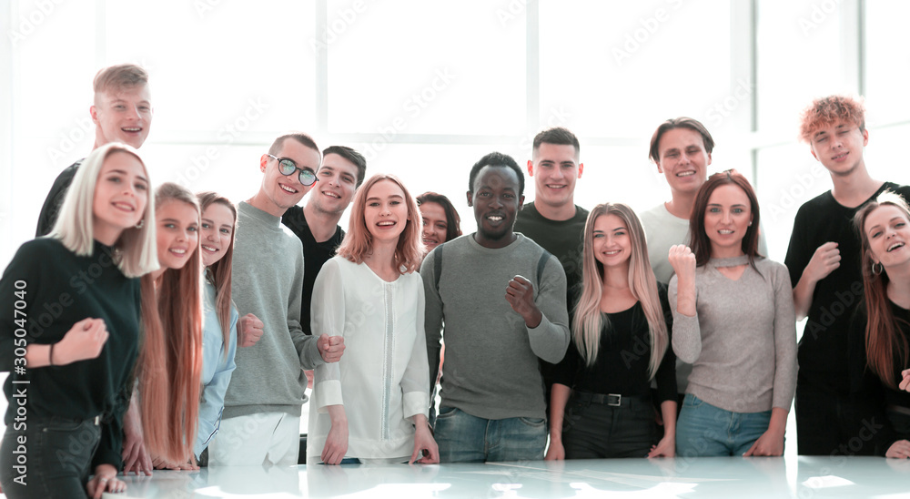 Fototapeta group of diverse young people standing together