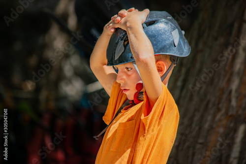 Fotografie, Tablou  Kid with helmet disappointed emotion.