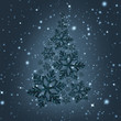 Fashionable creative Christmas tree made of snowflakes on a snowy background.