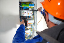 Electrician Testing The Electr...