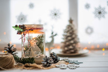 Christmas Or New Year Still Life With Candle Lamp And Decorative Ornaments On Rustic White Table. Christmas Objects With Empty Copy Space For Text.