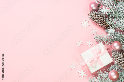 Door stickers Countryside Christmas flat lay background with christmas present box on pink.