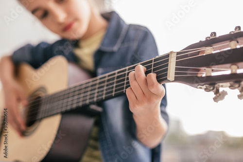 Blurred kid learning to play guitar Canvas Print