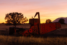 An Antique Combine And Tractor...