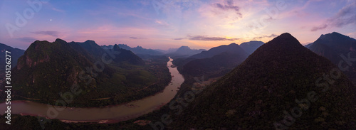 Poster Marron chocolat Aerial unique view from drone: Nam Ou river valley at Muang Ngoi Laos, sunset colorful sky, dramatic mountain landscape, travel destination in South East Asia