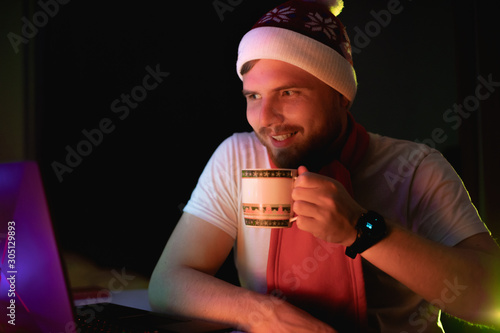 Christmas happy man with tea in the flat Canvas Print