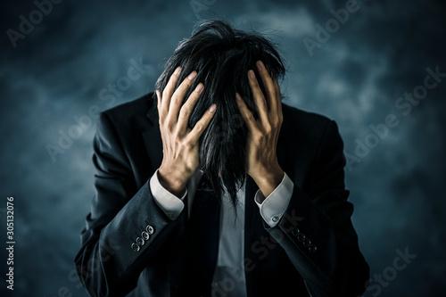 Photo 悩むビジネスマン