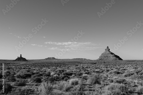 Black and white landscape of a distant monolith at Valley of the Gods in Bears Ears National Monument in Utah