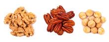 Heaps Of Peeled Pecan Nuts, Walnuts And Macadamia Isolated On White Background. Top View.