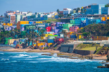 Colorful Houses Line The Hill Side Overlooking The Beach In San Juan, Puerto Rico.