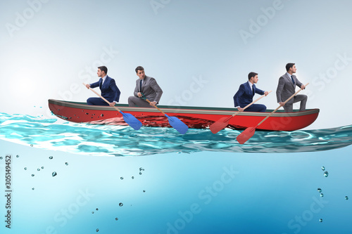 Canvastavla  Disagreement concept with businessmen rowing in different direct