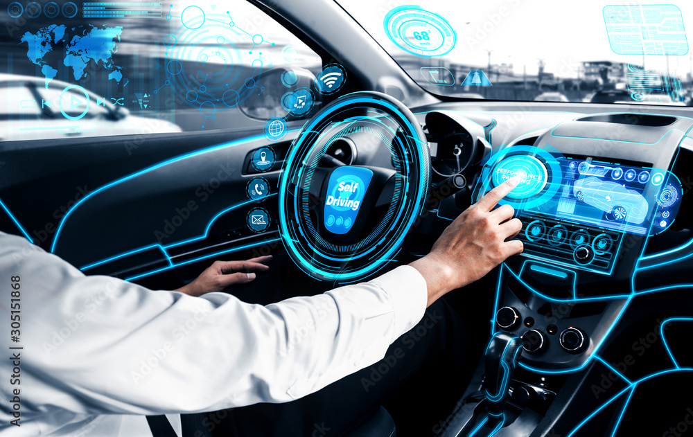 Fototapeta Self-driving autonomous car with relaxed young man sitting at driver seat is driving on busy highway road in the city. Concept of machine learning, artificial intelligence and augmented reality.