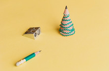 Creative Christmas Tree. Pencil For Shavings, Pencil And Sharpener On A Yellow Background. Christmas Concept In Office.