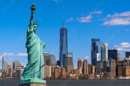 The Statue of Liberty over the Scene of New york cityscape river side which location is lower manhattan,Architecture and building with tourist concept - 305168081