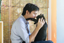 The Love Between A Black Cat And The Owner
