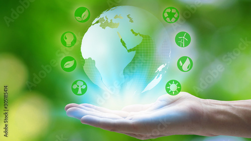 Fotomural Hand holding with earth and environment icons over the Network connection on nature background, Technology ecology concept