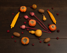 Background With Dried Poppy Heads, Ripe Orange Persimmon Fruits, Bottle Shaped Pumpkin Chinese Gourds Hu Lu, Putka Pods On Brown Wooden Table