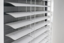 White Window Blinds With Refle...