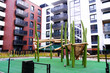 Wooden Playground for children in a cozy courtyard of modern apartment district.