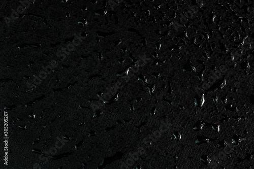 Obraz black flat rubber surface with water drops dark macro background - fototapety do salonu
