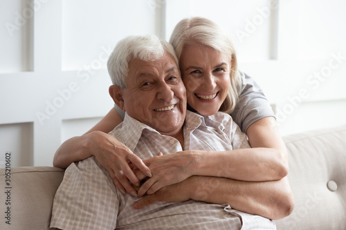 Pleasant middle aged woman embracing happy 80s father. Poster Mural XXL