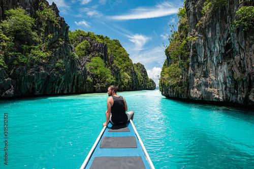 Obraz Palawan, Philippines, Traveler on Boat Deck Exploring Natural Sights Around El Nido - fototapety do salonu