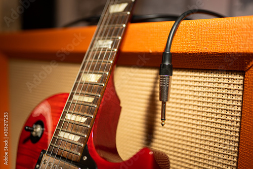 Photo Guitar amplifier with guitar plug and cable
