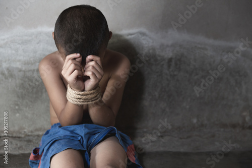 Fotografie, Tablou  victim child tied up with rope in emotional stress and pain