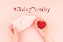 Giving Tuesday Concept With Red Heart In Hand