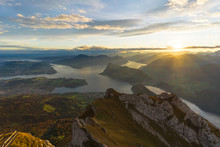 Beautiful Sunrise Panoramic View On Swiss Alps Around Lake Lucerne As Seen From Top Of Pilatus Kulm Peak