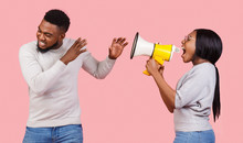 African American Girl Shouting Through Megaphone At Her Boyfriend