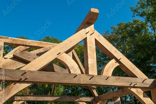 Fototapeta détail sur charpente en bois en construction