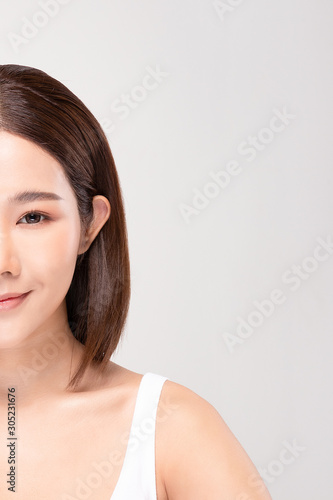 Carta da parati half of Beautiful Asian woman looking at camera smile with clean and fresh skin
