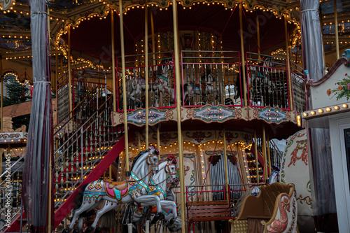 Vászonkép Carousel with horses