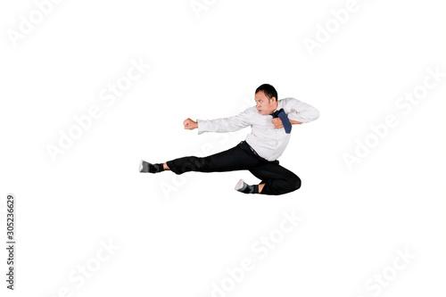 Fototapeta Aggressive Asian businessman doing kung fu kick in mid air