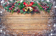 canvas print picture - Christmas background with bells, fir tree and decoration on dark wooden
