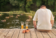 Men Relaxing With Beer On A Bo...