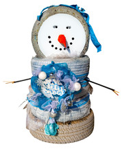 Sloppy Yet Adorable Snowperson Made From Old Car Tires, And Decorated With Stick Arms With Popsicle Stick Fingers And Garlands Of Fabric Remnants.