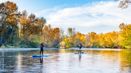Paddle Boarders on the autumn surrounded Boise River Wallpaper Mural
