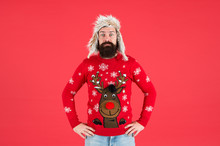 Take Him From Work To Xmas Party. Bearded Man With Festive Playful Look. Unshaven Man In Winter Style. Hipster Man In New Year Reindeer Design Jumper. Brutal Man With Long Beard Wear Warm Clothes