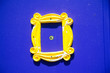 canvas print picture - Yellow frame or peephole on blue door. Pattern of Friends show
